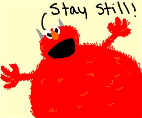A man gets tickled by Elmo